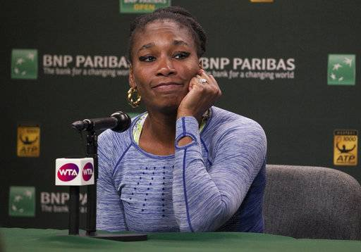 Venus Williams talks with media after defeating sister Serena Williams during the third round of the BNP Paribas Open tennis tournament at the Indian Wells Tennis Garden in Indian Wells, Calif., Monday, March 12, 2018. (AP Photo/Crystal Chatham)