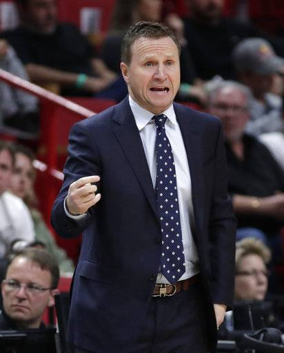 Washington Wizards head coach Scott Brooks watches the first half of an NBA basketball game against the Miami Heat, Saturday, March 10, 2018, in Miami. (AP Photo/Lynne Sladky)