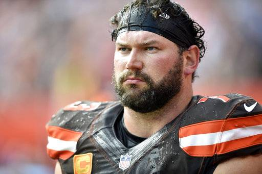 FILE - In this Oct. 22, 2017, file photo, Cleveland Browns offensive tackle Joe Thomas walks on the sideline during an NFL football game against the Tennessee Titans in Cleveland. Thomas has not informed Cleveland of his future plans as the team prepares to sign free agents. Thomas has been mulling whether to continue his playing career for months. The 10-time Pro Bowler suffered a season-ending injury in 2017, and Thomas is still recovering from surgery to repair his torn left triceps. (AP Photo/David Richard, File)
