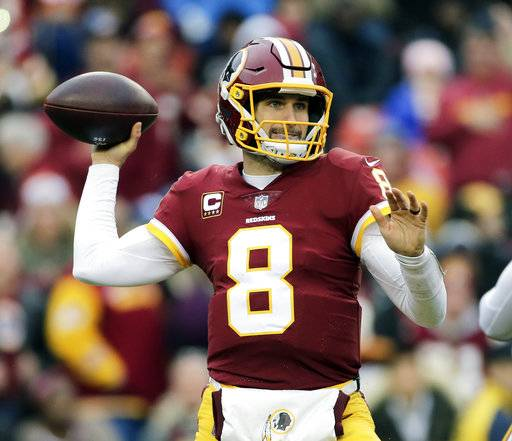 FILE - In this Dec. 17, 2017, file photo, Washington Redskins quarterback Kirk Cousins (8) throws the ball during an NFL football game against the Arizona Cardinals, in Landover, Md. Free agent quarterback Kirk Cousins is predictably the top priority on Minnesota's offseason shopping list. Cousins will visit with the Vikings on Wednesday, March 14, 2018, after the league year begins, his agent Mike McCartney said. (AP Photo/Mark Tenally, File)