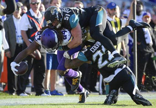 FILE - In this Dec. 11, 2016, file photo, Minnesota Vikings wide receiver Cordarrelle Patterson (84) is stopped by Jacksonville Jaguars middle linebacker Paul Posluszny (51) and cornerback Aaron Colvin (22) after a reception during the second half of an NFL football game, in Jacksonville, Fla. Jaguars Paul Posluszny, the second-leading tackler in franchise history, is retiring from the NFL after 11 seasons. The 33-year-old Posluszny announced his decision in a letter to fans Tuesday, March 13, 2018, one day before he was scheduled to become an unrestricted free agent. (AP Photo/Phelan M. Ebenhack, File)
