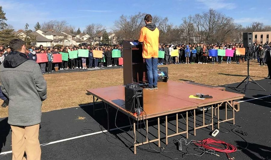 A student addresses fellow classmates at Plum Grove Junior High in Rolling Meadows who participated in the nationwide school walkout Wednesday.