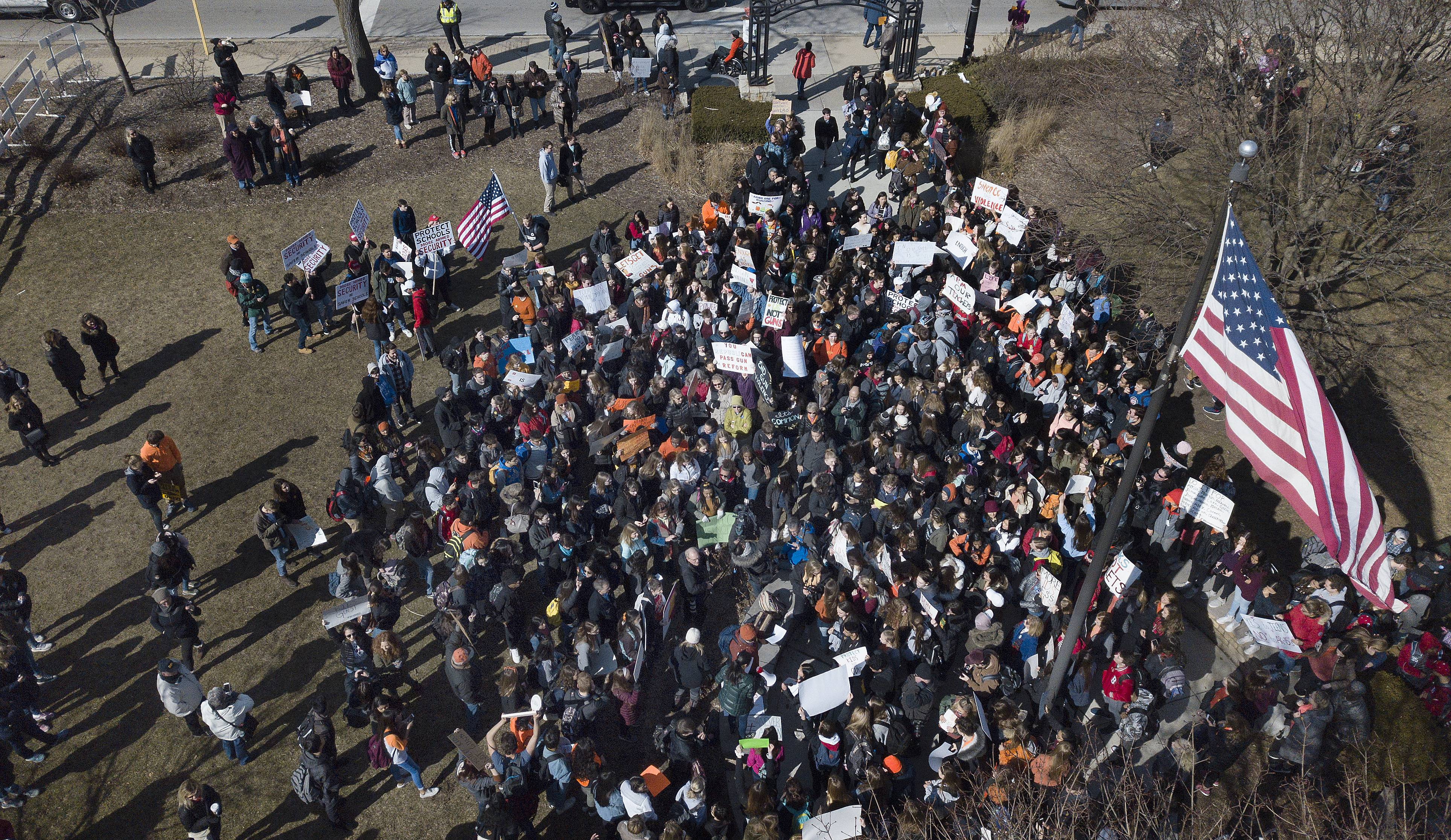 Nearly 500 Barrington High School students gather in Memorial Park near downtown Barrington to protest gun violence in schools and across the nation.