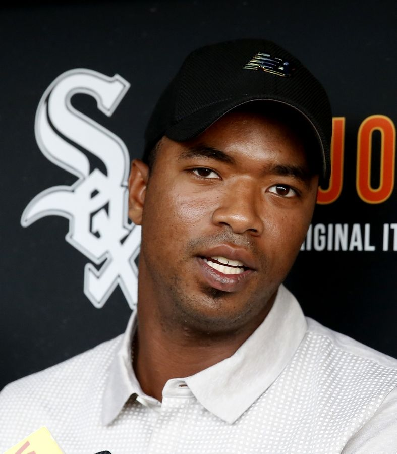Eloy Jimenez, an outfielder with the Birmingham Barons, a Double-A affiliate of the Chicago White Sox, talks with reporters before a baseball game between the White Sox and the Cleveland Indians on Tuesday, Sept. 5, 2017, in Chicago.