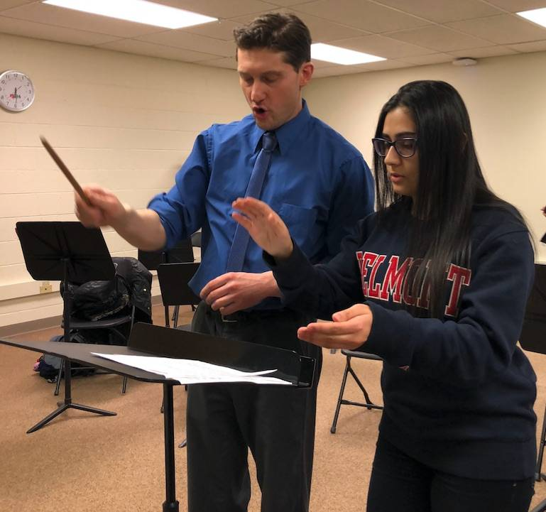 David Hain, left, 214Sings director and conductor, shares conducting techniques with Tayma Mansour, a Community Education intern and a senior from Rolling Meadows High School, during one of the 214Sings classes. Tayma's internship is through District 214's Career Pathways Internship program.District 214 Community Education