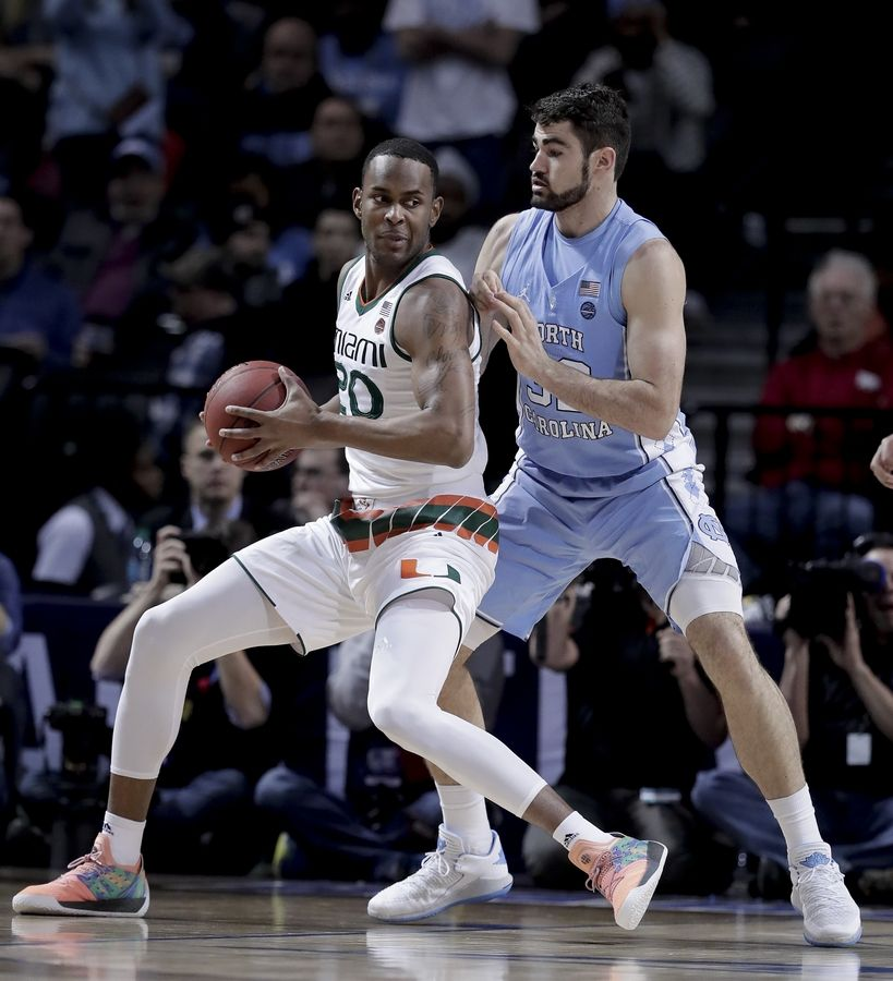 Miami forward Dewan Huell (20) drives against North Carolina forward Luke Maye (32) during the first half of an NCAA college basketball game in the Atlantic Coast Conference men's tournament Thursday, March 8, 2018, in New York.