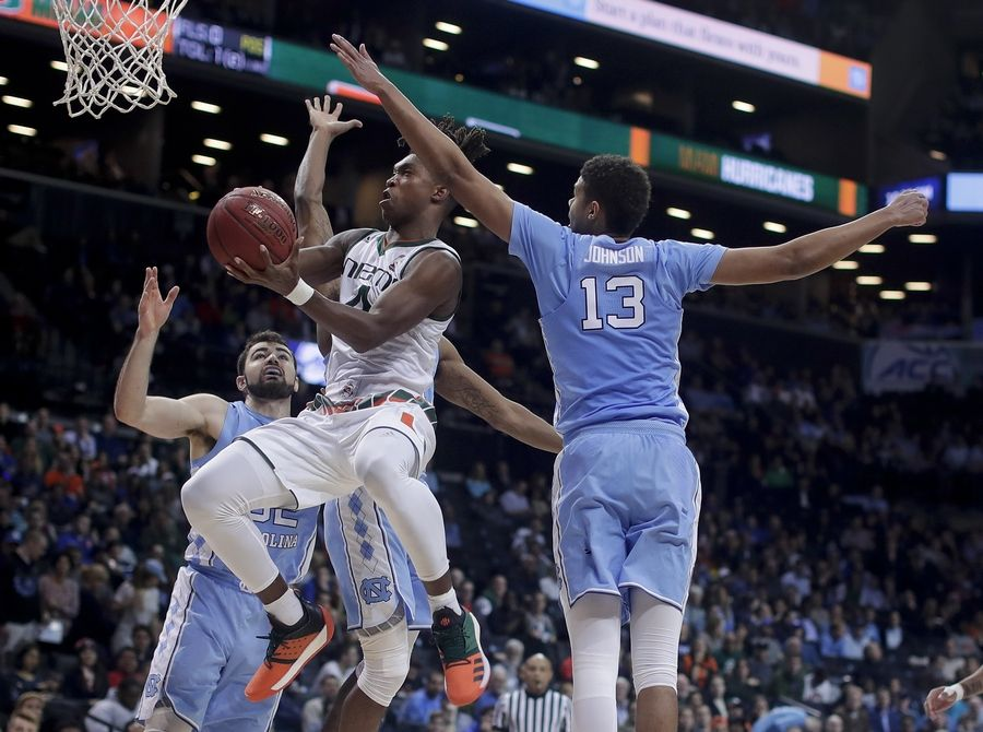 Miami guard Lonnie Walker IV (4) shoots against North Carolina guard Cameron Johnson (13) during the second half of an NCAA college basketball game in the Atlantic Coast Conference men's tournament Thursday, March 8, 2018, in New York.