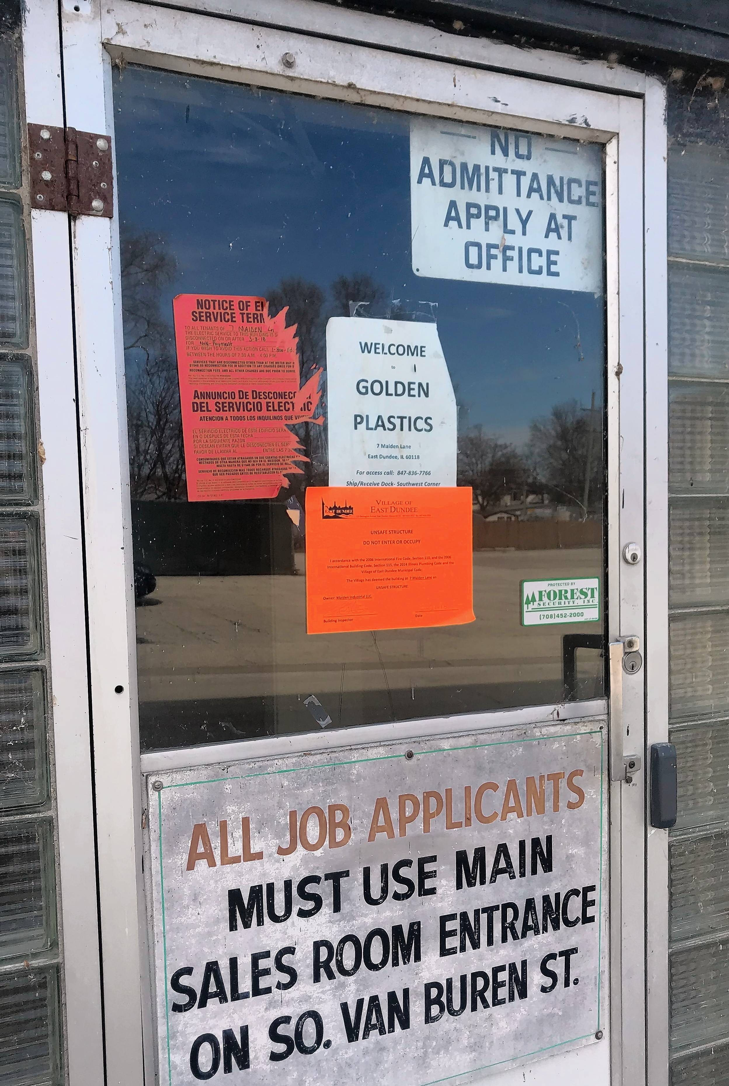 A notice on the door of the former Haeger Potteries plant in East Dundee deems the building unsafe for occupancy.