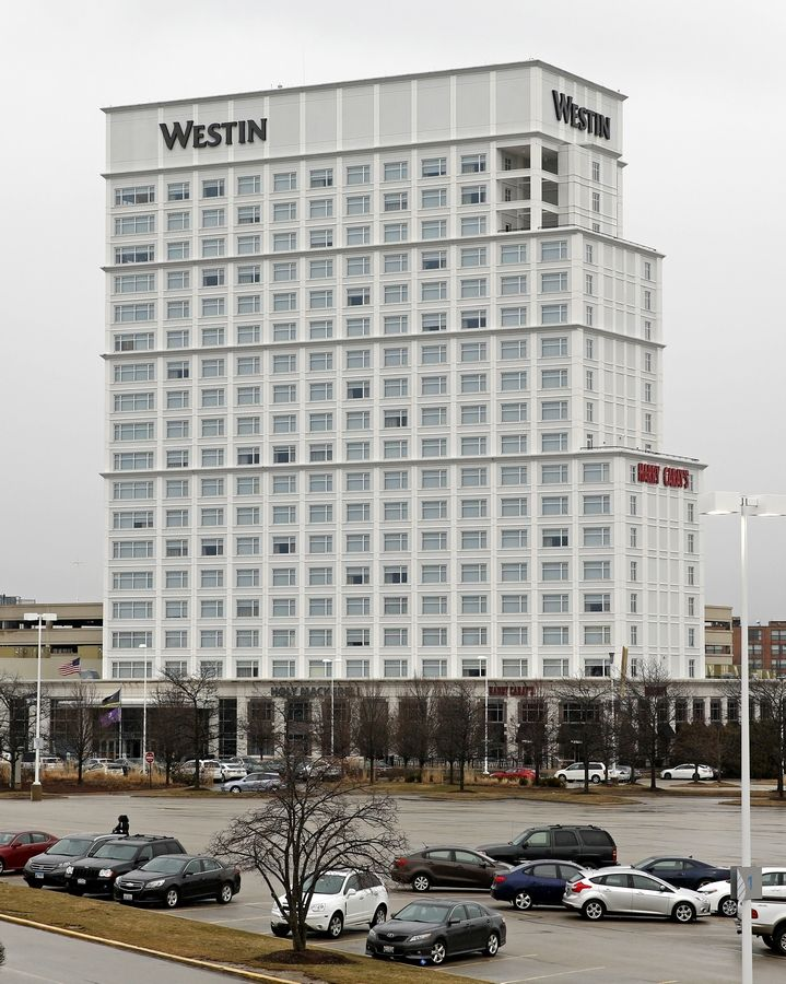 The 18-story, 500-room Westin Lombard Yorktown Center hotel will remain open as the agency that owns it begins to make payments on $142 million in new bonds issued to replace $264 million in debt as part of bankruptcy restructuring proceedings.