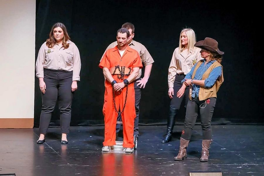 Attorney Christopher Ward was shackled to a dolly while portraying Judge Daniel O'Shea during the 'Hannibal O'Shea' skit performed at this month's Judges' Nite variety show. The event raised about $30,000 to provide legal assistance to low-income families.
