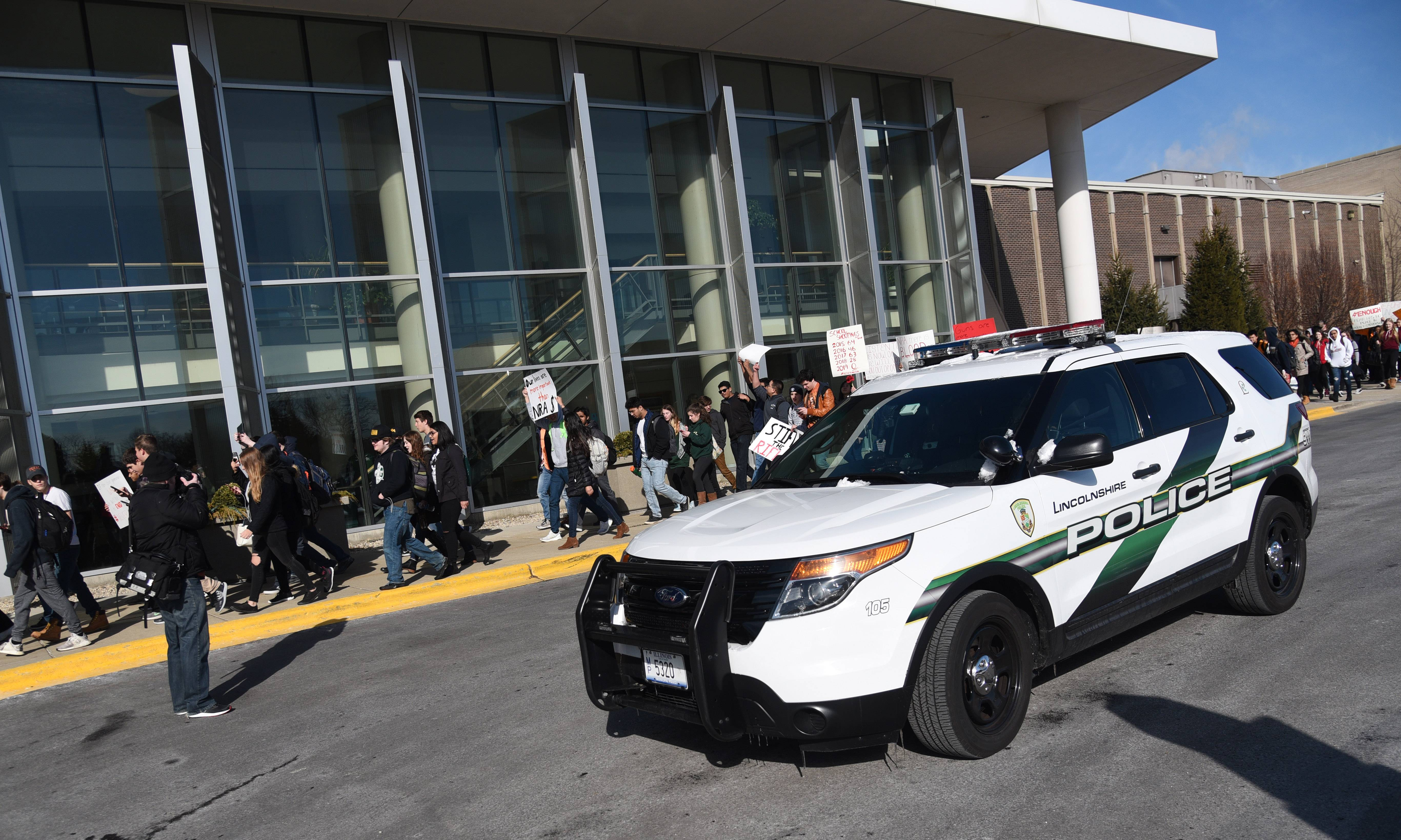Lincolnshire police officers patrolled the parking lots and blocked entrances to Stevenson High School Wednesday morning as students participated in a walkout against gun violence.