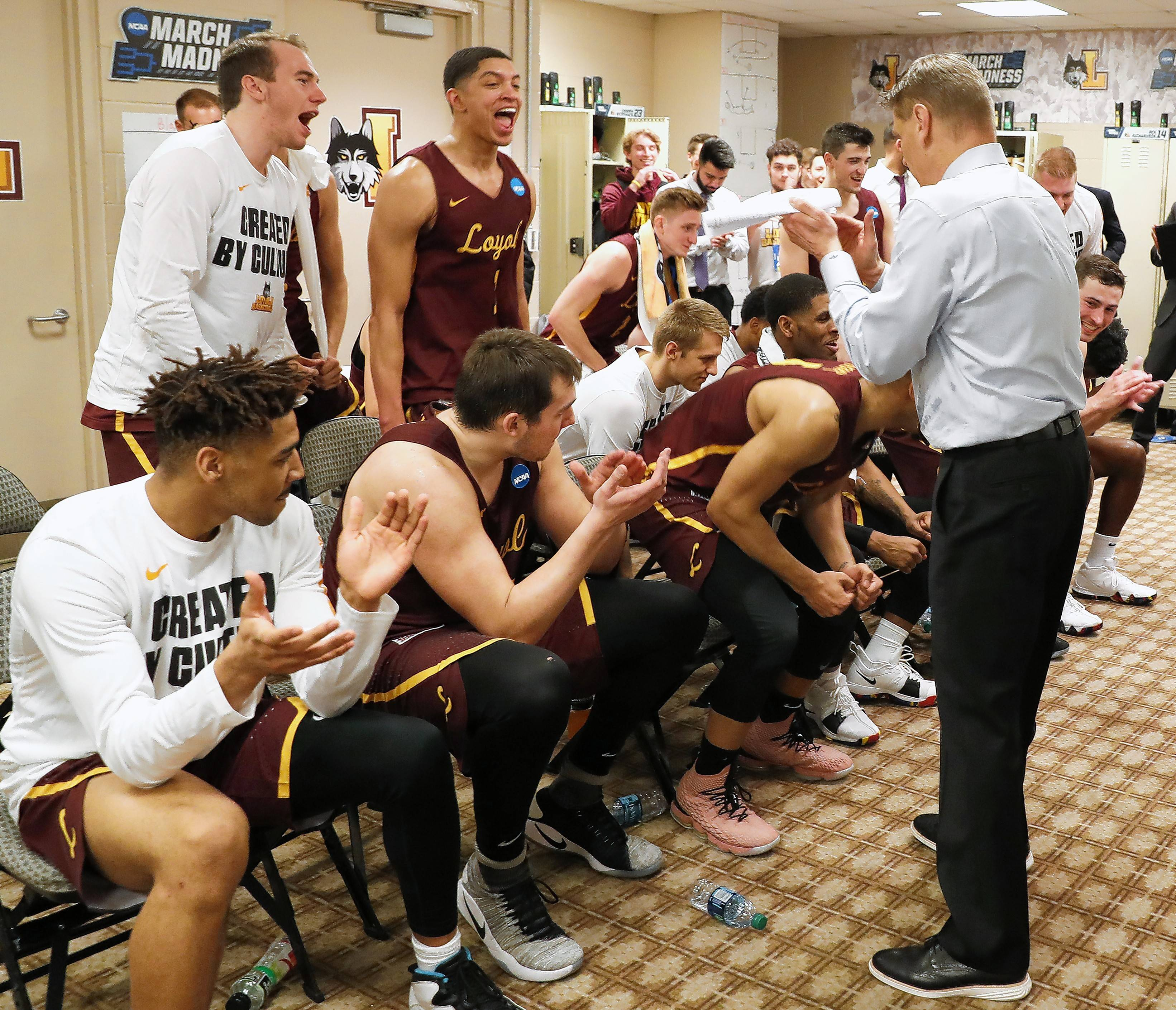 Loyola Ramblers head coach Porter Moser addresses his team after their stunning buzzer-beating upset of the University of Miami on Thursday in Dallas. Today Loyola plays Tennessee.