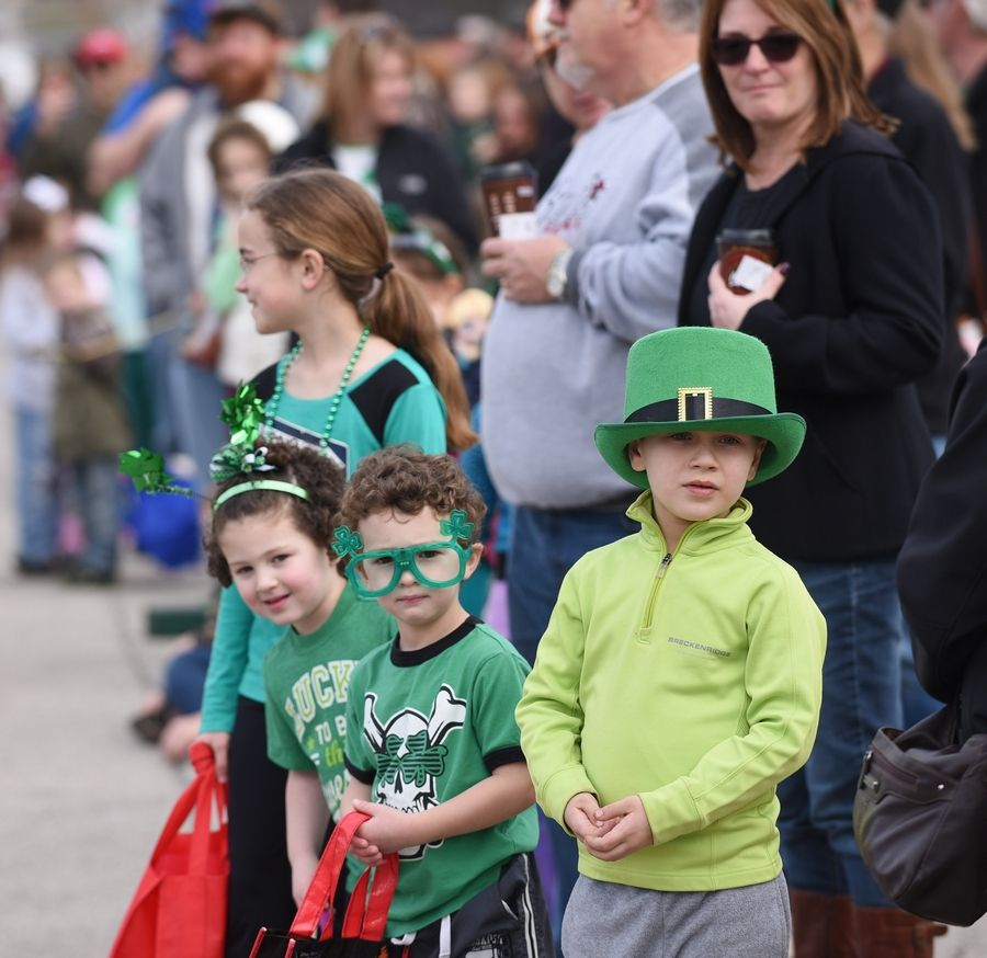 Families line the route for the annual Lake Villa St. Patrick's Day parade, returning Saturday.