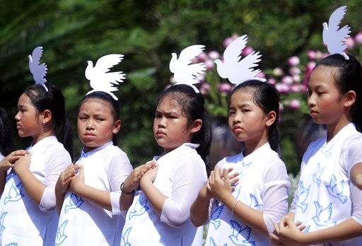 Young dancers participate in a performance during a ceremony to remember victims of My Lai massacre in My Lai, Vietnam Friday, March 16, 2018. More than a thousand people attend the commemoration marking the 50th anniversary of the My Lai massacre in which 504 unarmed civilians, most of them women, children and the elderly. (AP Photo/ Hau Dinh)