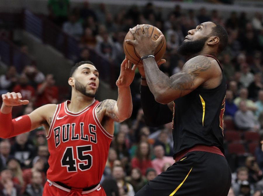 4cfb5850d2a Cleveland Cavaliers forward LeBron James, right, drives to the basket  against Chicago Bulls guard