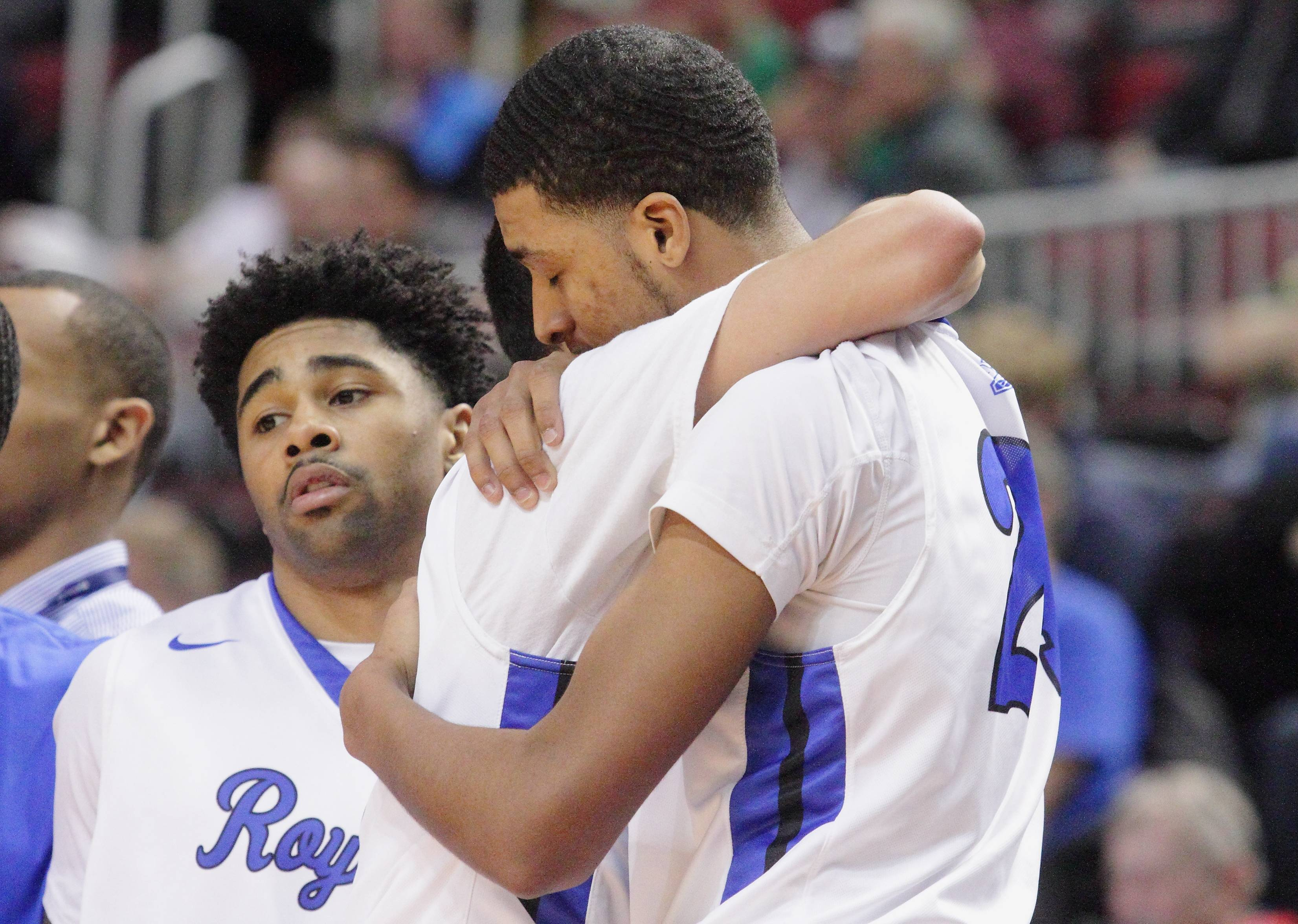 Larkin's Isaiah Talley hugs teammate Victor Perez after leaving the game late in the fourth quarter during the Royals' 61-49 loss to Evanston on Saturday in the Class 4A third-place game in Peoria.