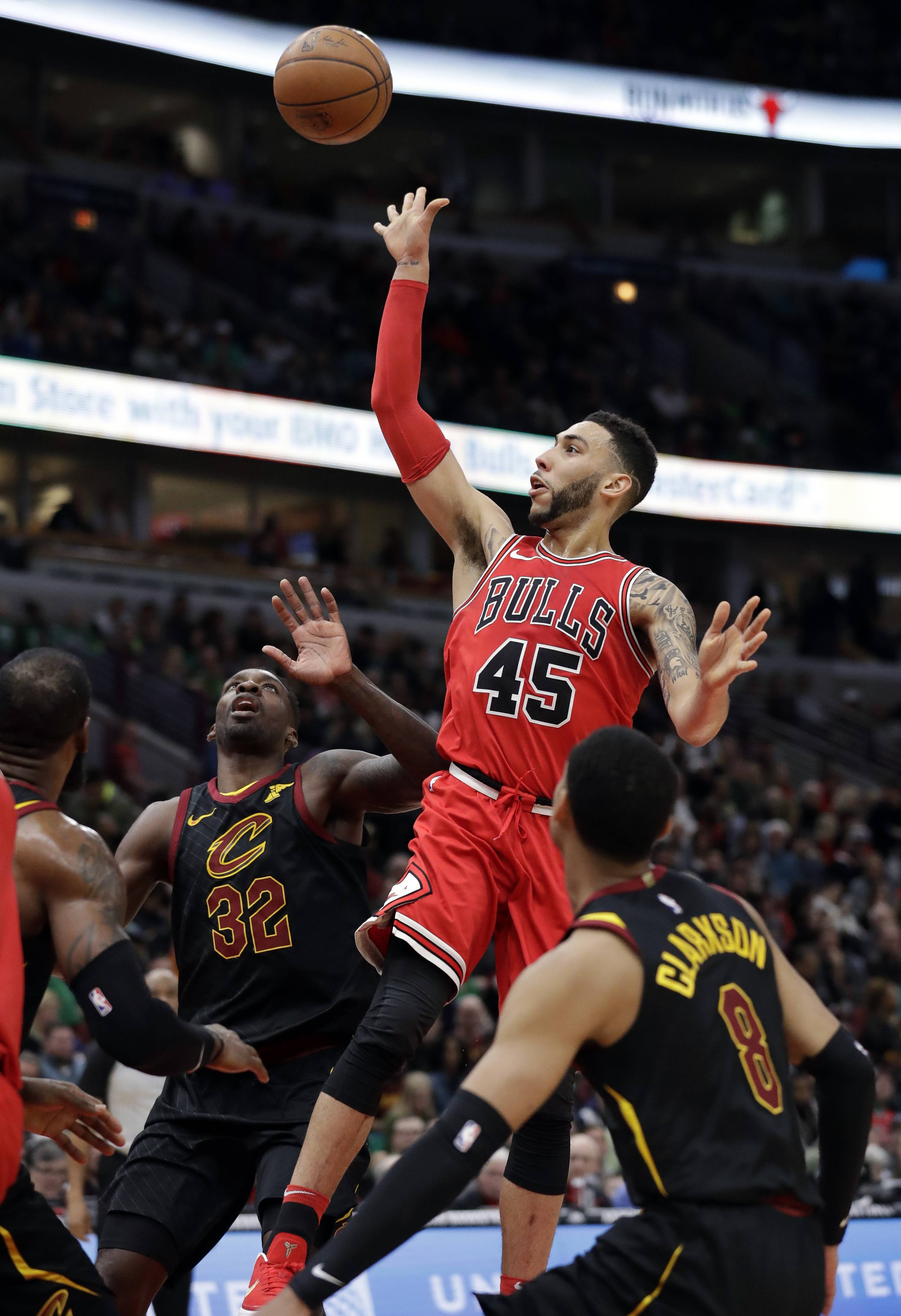 Chicago Bulls guard Denzel Valentine (45) shoots against the Cleveland Cavaliers during the second half of an NBA basketball game Saturday, March 17, 2018, in Chicago. The Cavaliers won114-109. (AP Photo/Nam Y. Huh)