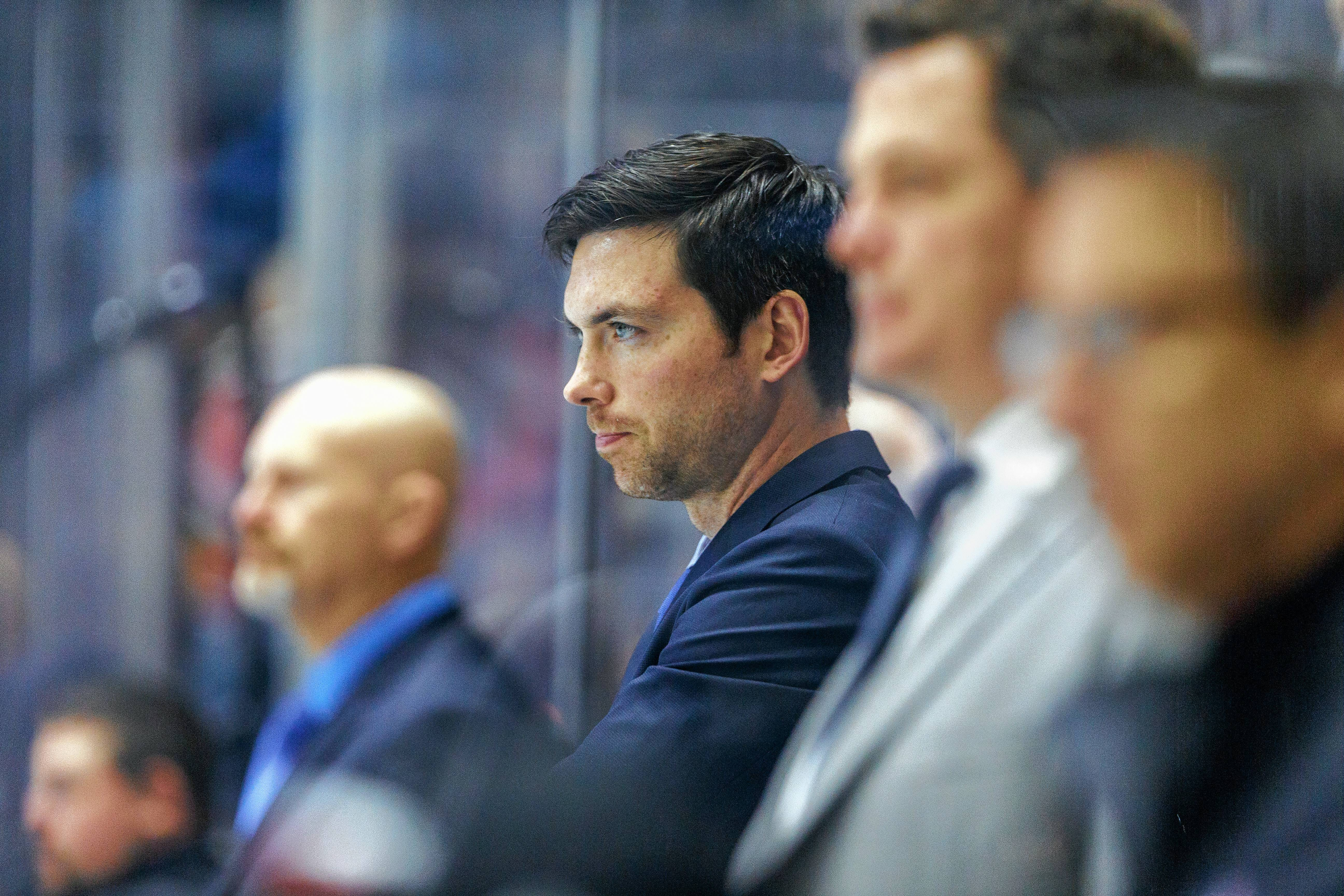 Rockford IceHogs head coach Jeremy Colliton, center, believes his young team has what it takes to make the AHL Calder Cup playoffs.