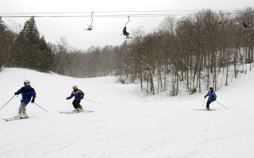 In this March 15, 2018, photo, skiers head down a slope at Mad River Glen in Fayston, Vt. Three successive March snowstorms have provided good conditions for late-season skiing.