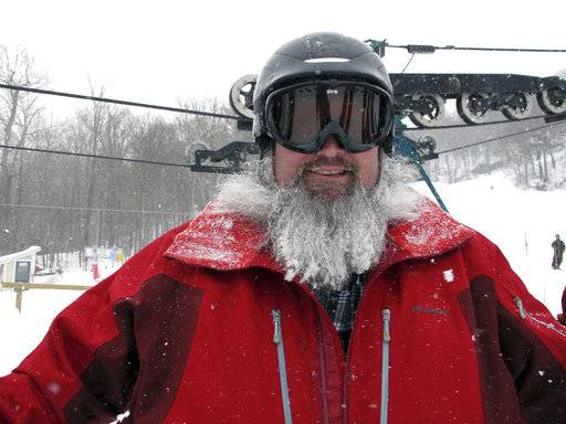 In this March 15, 2018, photo, Paul Carney of Huntington, Vt., waits in line to board the single-person chairlift at Mad River Glen in Fayston, Vt. Three successive March snowstorms have provided good conditions for late-season skiing.