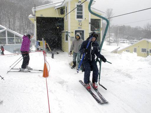 In this March 15, 2018, photo, skiers board the chairlift at Mad River Glen in Fayston, Vt. Three successive March snowstorms have provided good conditions for late-season skiing.