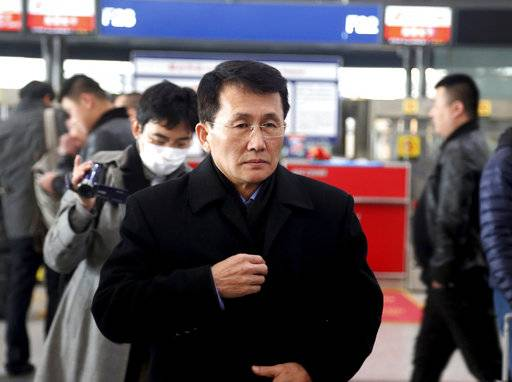 Choe Kang Il, a senior North Korean diplomat handling North American affairs, is seen at the Beijing Capital International Airport in Beijing Sunday, March 18, 2018. Cho is heading to Finland for talks with the U.S. and South Korea. (Kim Jin-bang/Yonhap via AP)