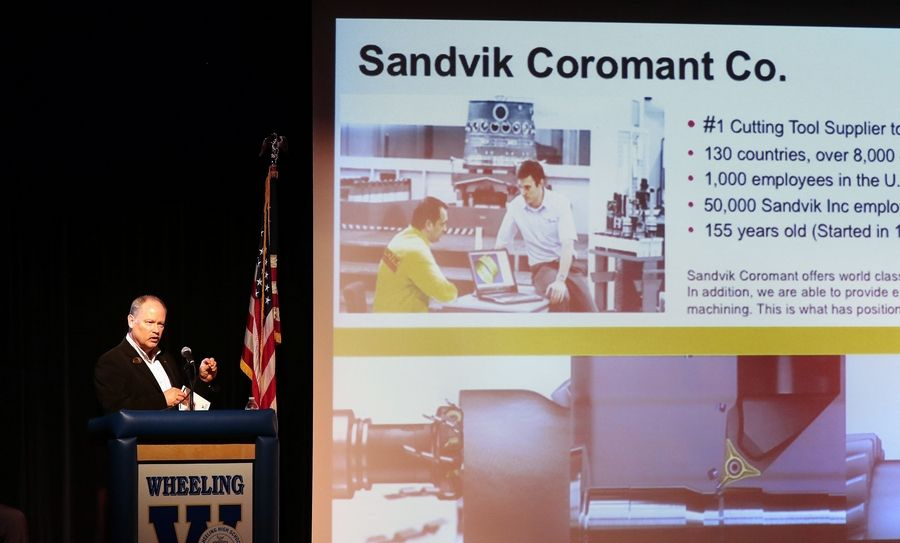 Sandvik Coromant Co. manager Kevin Clay speaks to Wheeling High School students Monday during the school's Manufacturing Open House.
