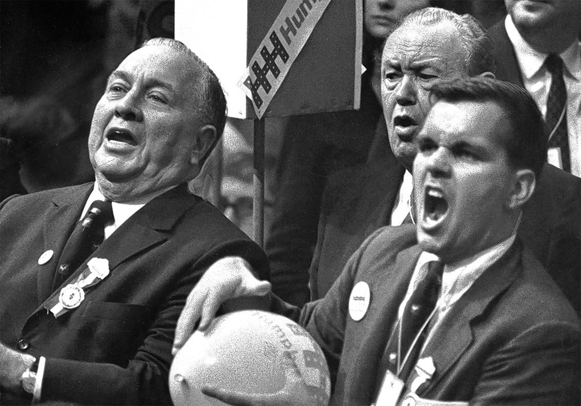 Mayor Richard J. Daley and son Richard M. Daley jeer Sen. Abraham Ribicoff at the Democratic National Convention as he criticizes Chicago Gestapo tactics.