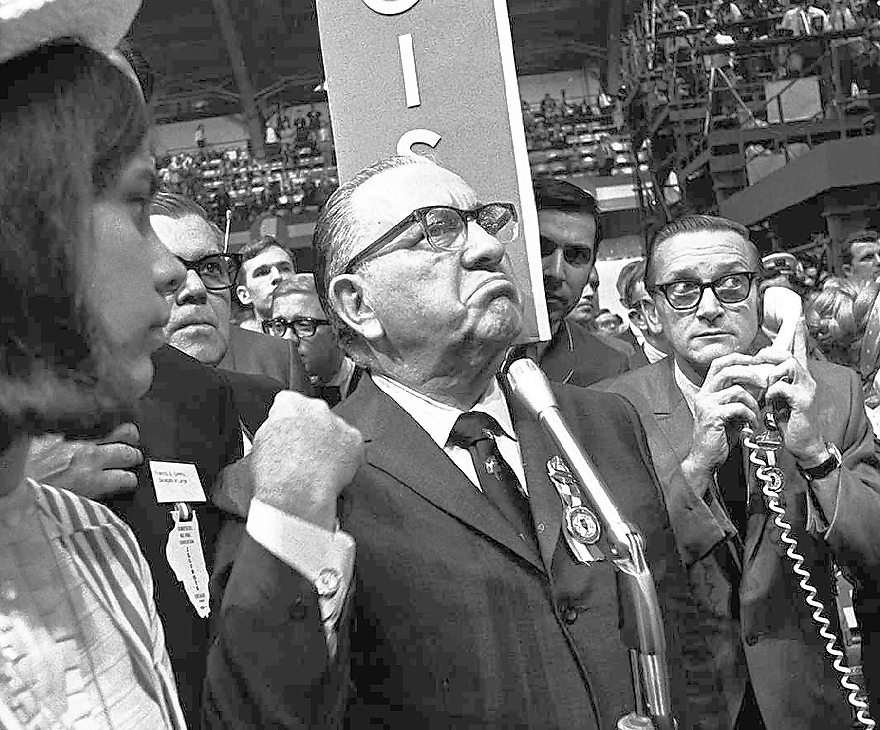 A furious Mayor Richard J. Daley stands at the microphone as shouts resound through the International Amphitheatre in Chicago, demanding the Democratic National Convention adjourn until later in the day before considering the party platform. Daley contended spectators in the galleries were doing the shouting. Daley was seated front-row center, directly below the rostrum. It was the position of honor; but it was also ground zero in a year of political and social upheaval.