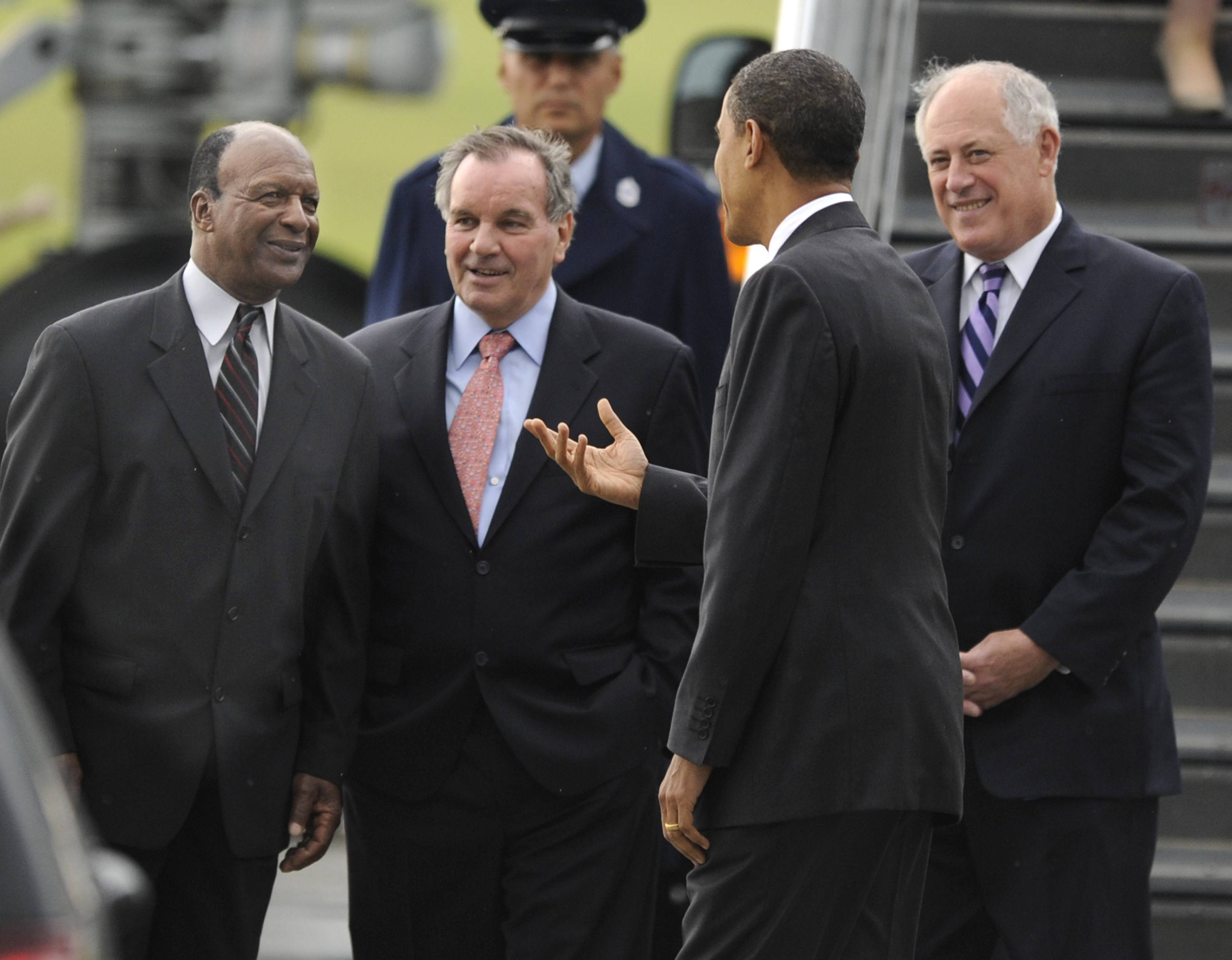 President Barack Obama, right, is greeted by Illinois Secretary of State Jesse White, left, Chicago Mayor Richard M. Daley, center, and Illinois Gov. Pat Quinn after arriving at O'Hare Airport in Chicago.