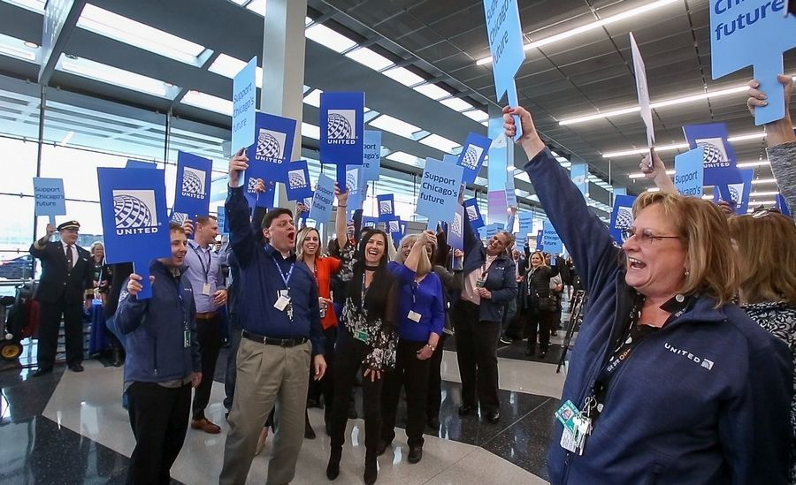 John Sarullo, business office supervisor, second from left, leads a chant of United employees as they rallied at O'Hare International Airport last week to support the O'Hare 21 expansion project.