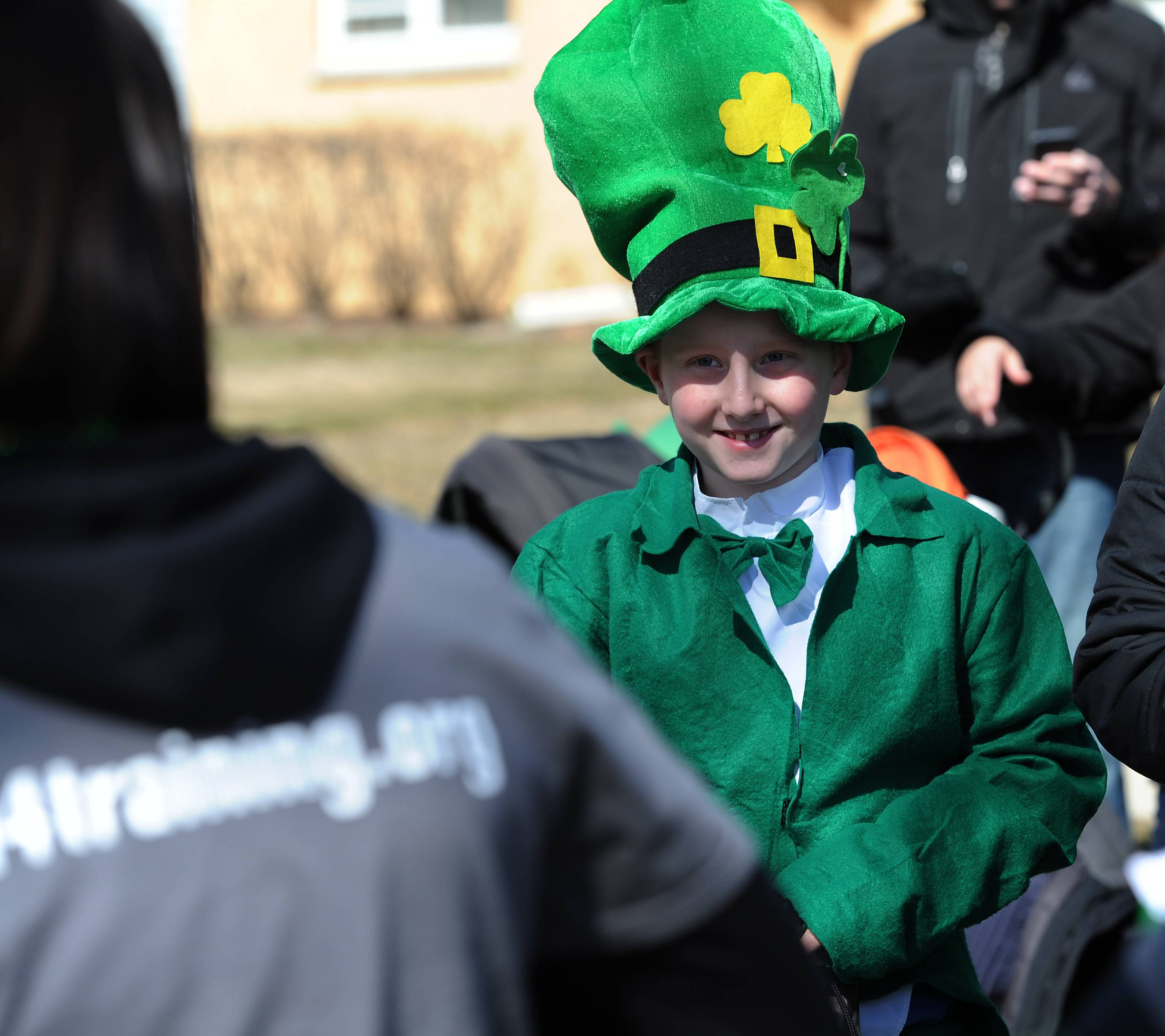 Mark Welsh/mwelsh@dailyherald.comJ.P. Camacho, 10, of Arlington Heights flashes his big Irish smile as he watches the Palatine's Paint the Town Green festival parade on Saturday.