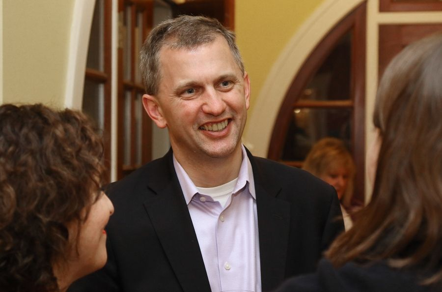 Democratic candidate Sean Casten talks with family and friends as he waits for results in the 6th Congressional District race Tuesday in Hinsdale. Casten narrowly edged Barrington Hills Plan Commissioner Kelly Mazeski and now will prepare for a general election battle with incumbent Republican Rep. Peter Roskam of Wheaton.