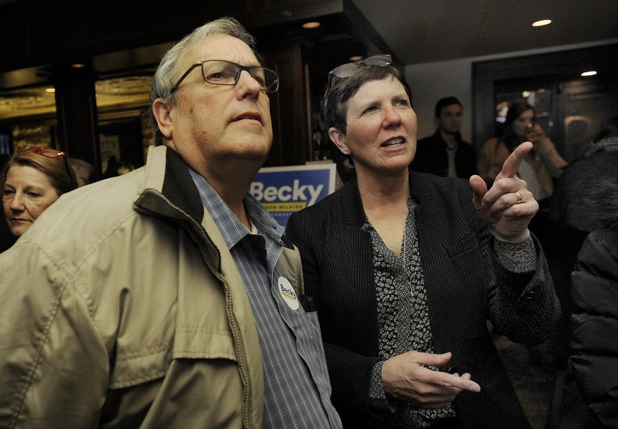 Campaign supporter Jim Kopchok of Naperville watches results pour in Tuesday in Wheaton with Becky Anderson Wilkins, a Democratic candidate in the 6th Congressional District.