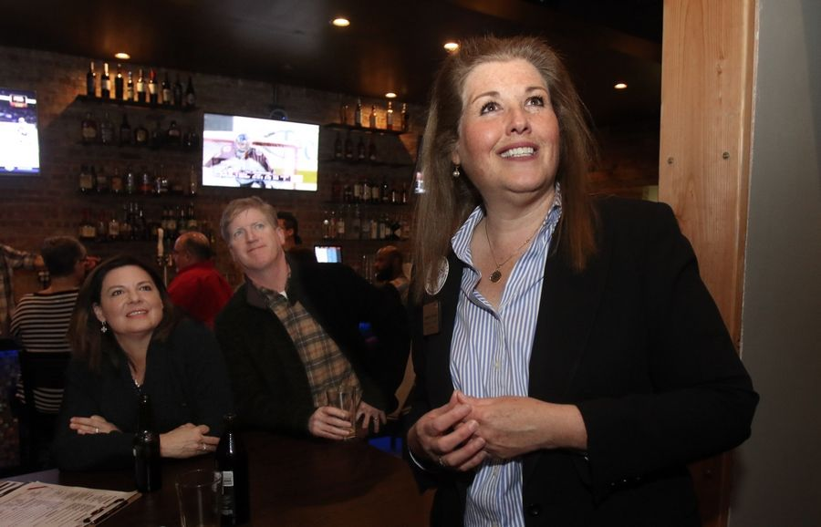 Democratic candidate Jennifer Zordani of Clarendon Hills watches results come in for the 6th Congressional District race with family and friends Tuesday at Johnny's Blitz Bar and Grill in Westmont.