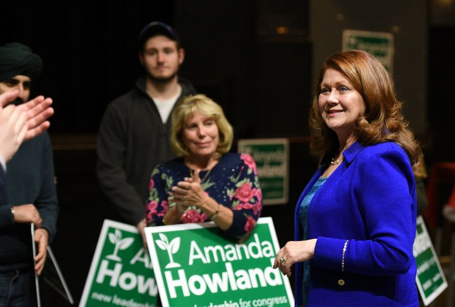 Democratic candidate for the 6th Congressional District Amanda Howland thanks her supporters Tuesday at Durty Nellie's in Palatine.