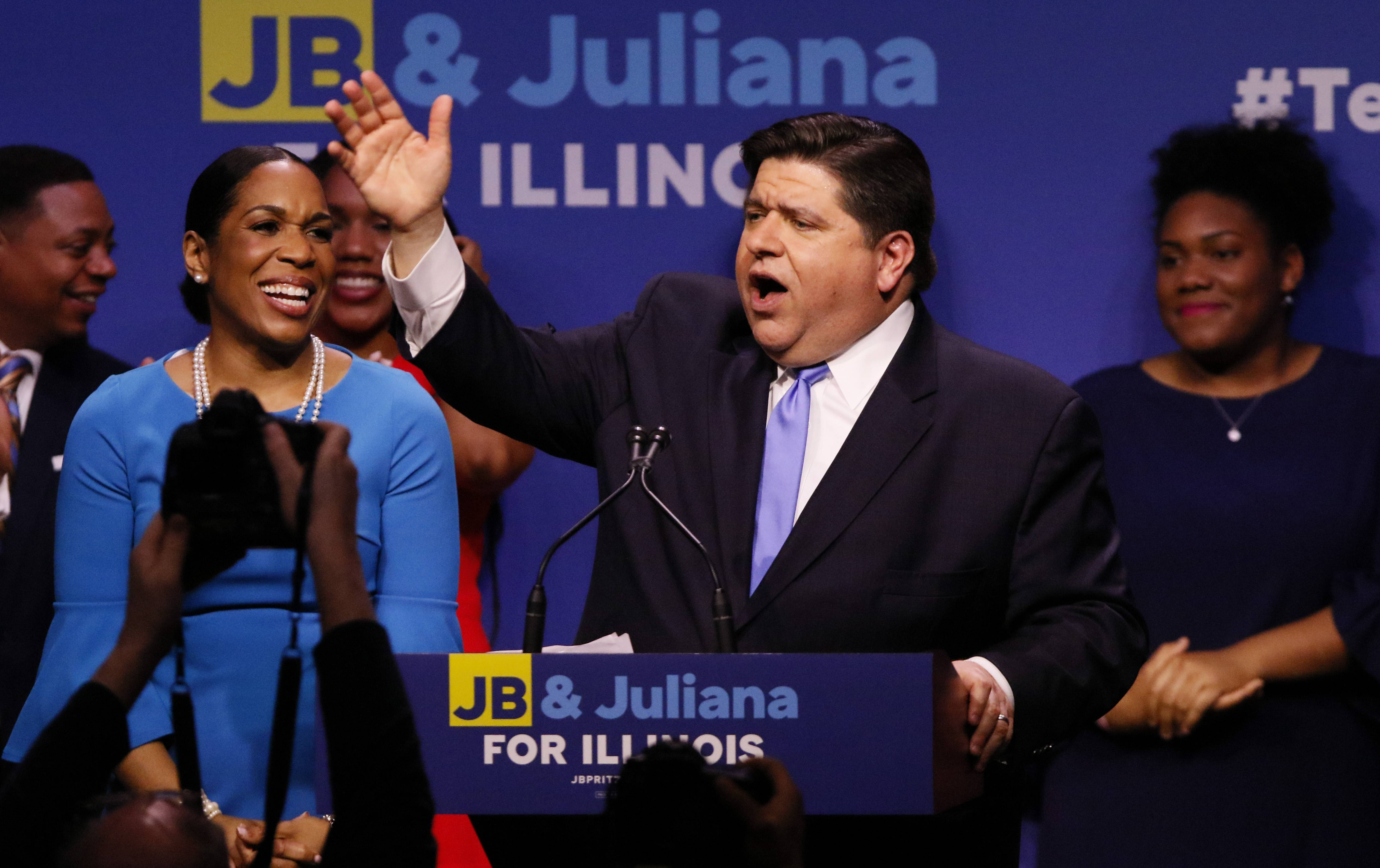 Democratic candidate for governor J.B. Pritzker celebrates his primary election victory at the Marriott Marquis Chicago. At left is Pritzker's running mate Juliana Stratton.