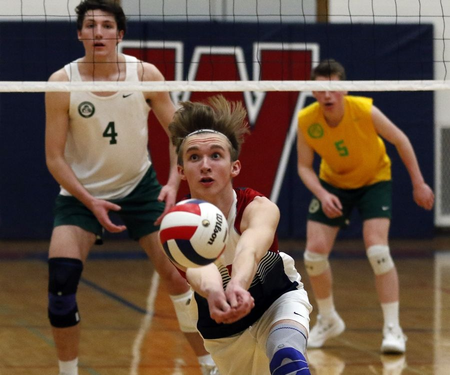West Aurora's Danny Risner dives for a ball Tuesday during boys volleyball at West Aurora High School.