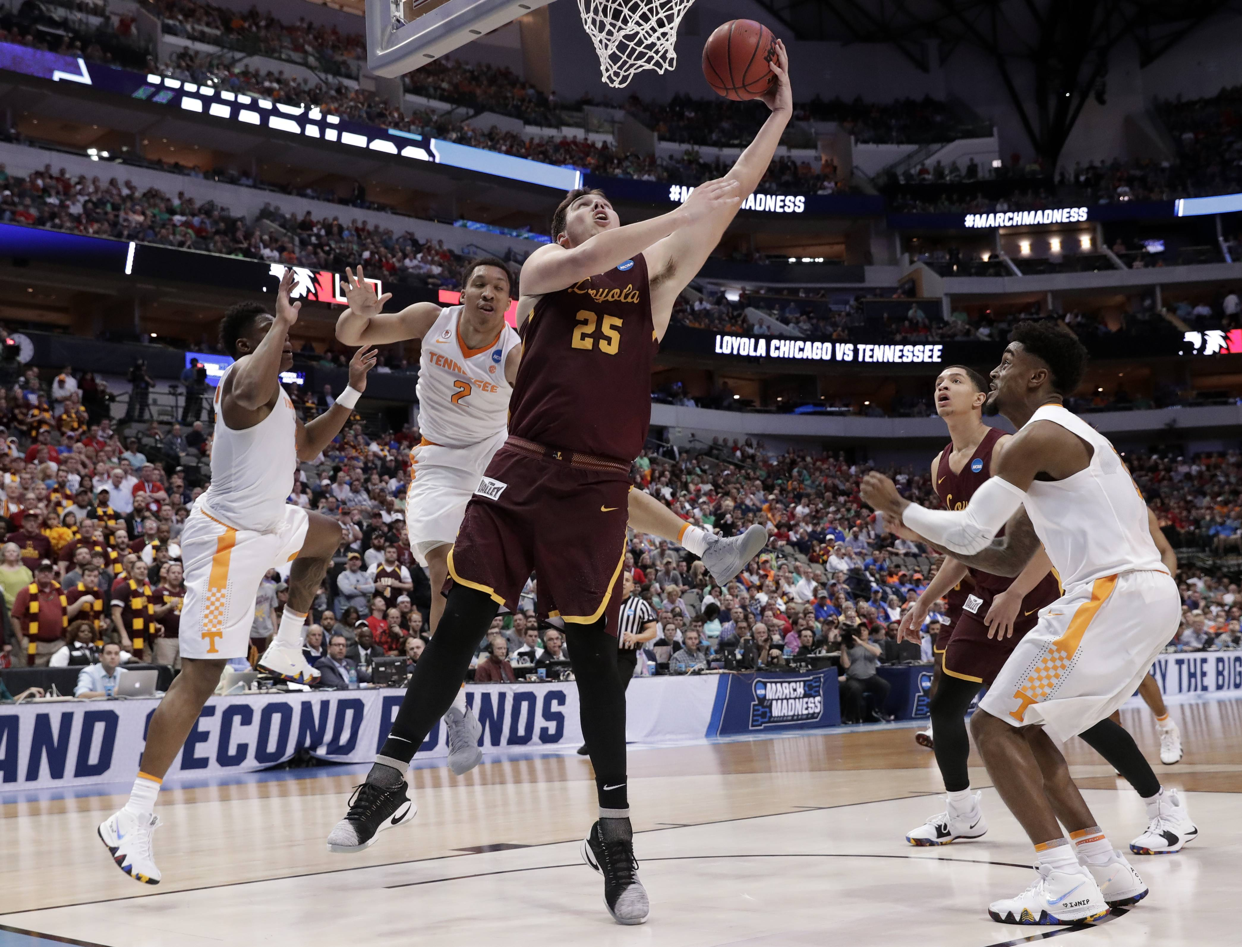 Loyola center Cameron Krutwig goes up for a shot after getting past a trio of Tennessee defenders in Saturday's second-round NCAA victory at Dallas. The all-around play of the freshman from Algonquin has been much appreciated by his Ramblers teammates. (AP Photo/Tony Gutierrez)