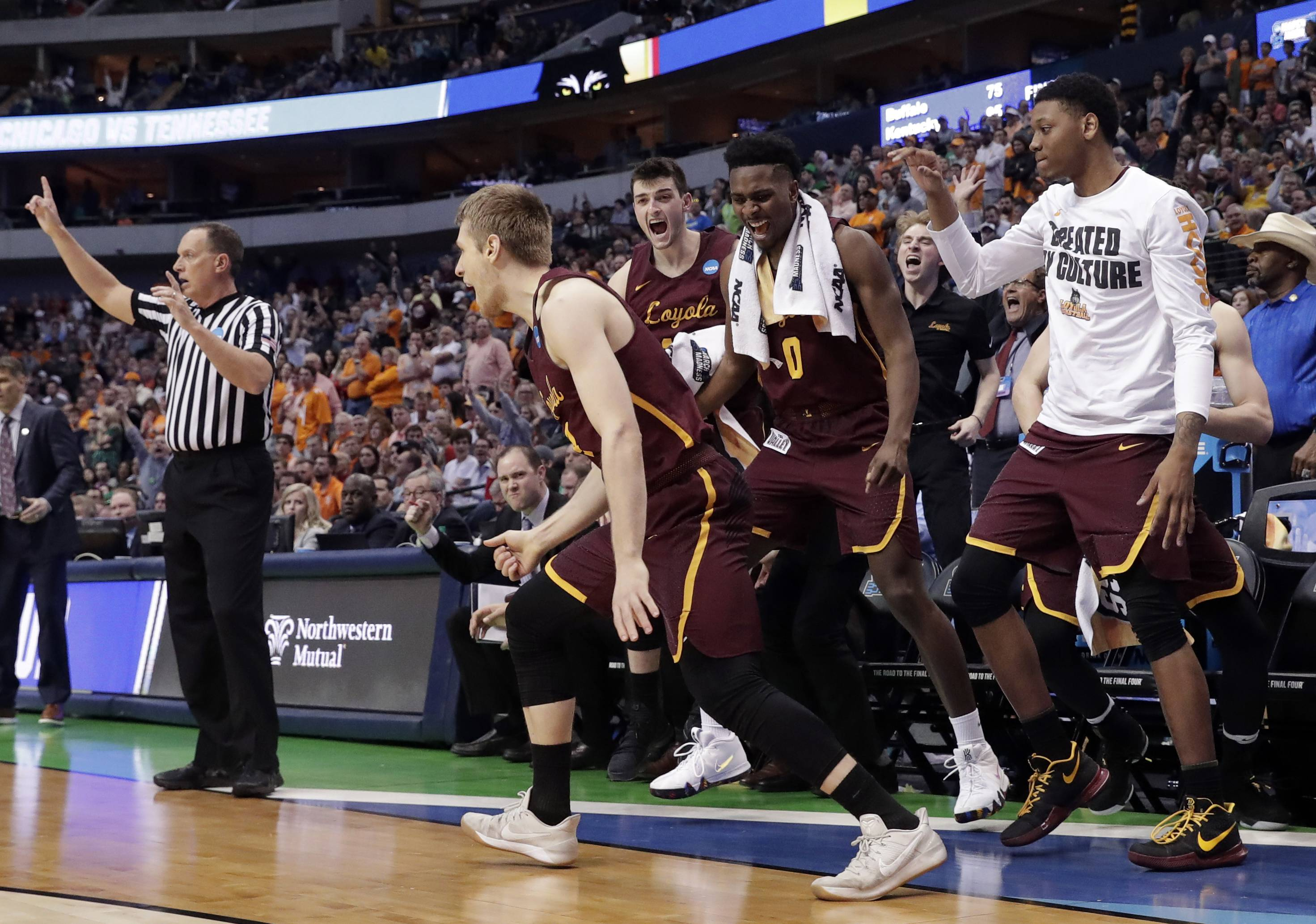The bench celebrates after Loyola-Chicago guard Bruno Skokna scored on a 3-point basket against Tennessee in the second half of a second-round game at the NCAA men's college basketball tournament in Dallas, Saturday, March 17, 2018. (AP Photo/Tony Gutierrez)