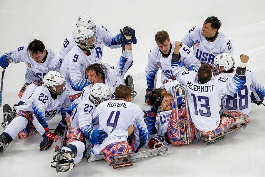 Members of the USA Sled Hockey Team celebrating their gold-medal win over Canada on Sunday at the 2018 Paralympic Winter Games in South Korea. That's Brody Roybal (No. 4 ) of Northlake in te center.