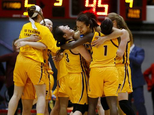 Members of the Central Michigan basketball team celebrate a second-round game victory over Ohio State in the NCAA women's college basketball tournament in Columbus, Ohio, Monday, March 19, 2018.