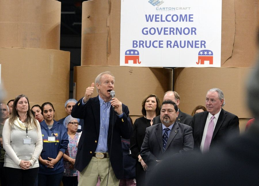 Gov. Bruce Rauner talks to employees of Carton Craft in St. Charles as he kicks off his general election campaign Wednesday.