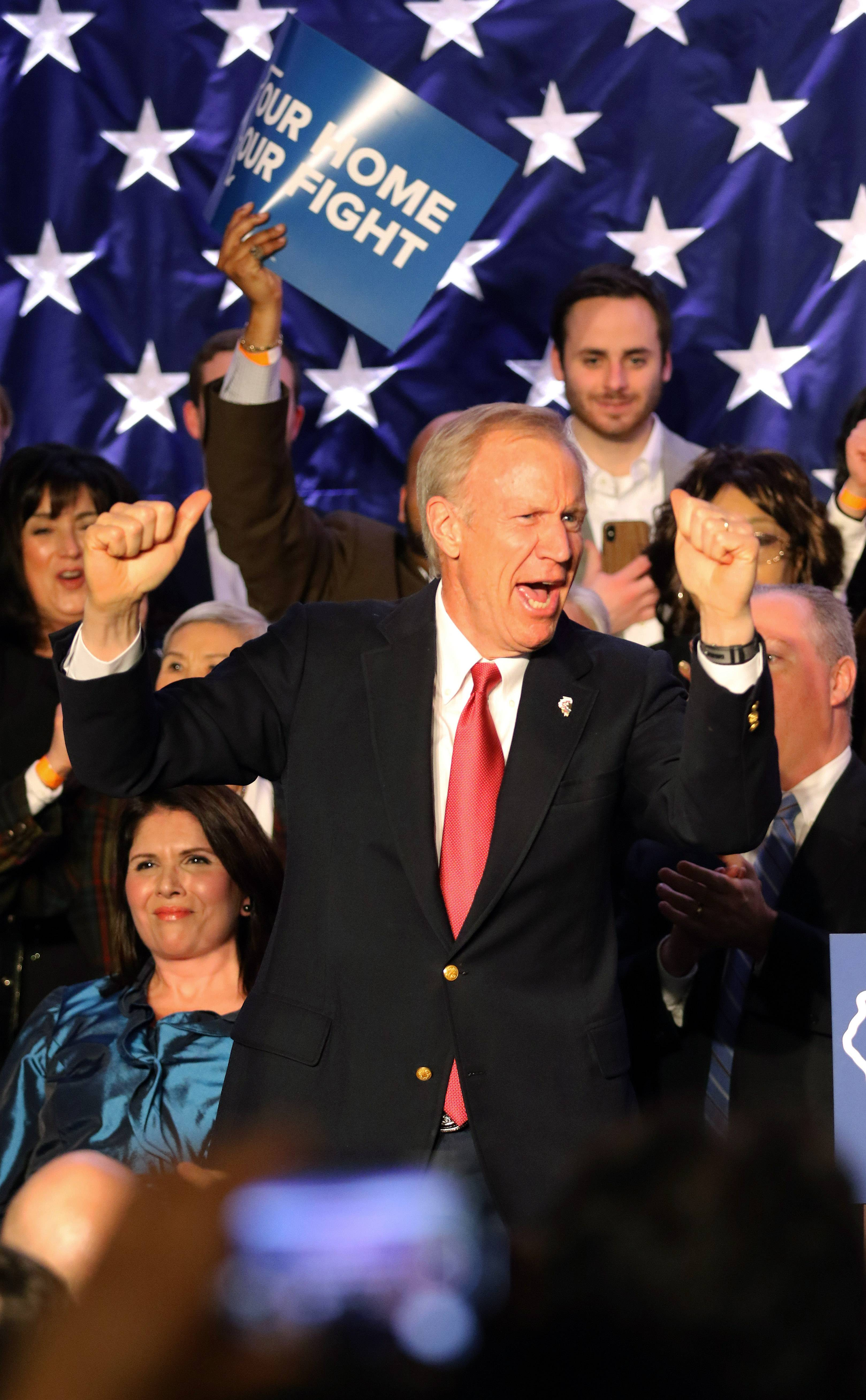 Gov. Bruce Rauner cheers during his speech after his primary election victory Tuesday.