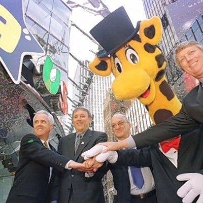 "Toys ""R"" Us founder Charles Lazarus, who has died at 94, is shown second from right at the 2001 grand opening of the new Toys R Us store in New York's Times Square. Also pictured are Elliott Wahle, vice president and general manager of the new store, from left; John Eyler, chairman, president and CEO; and Gregory Staley, president, U.S. toy stores, with company mascot Geoffrey the Giraffe."