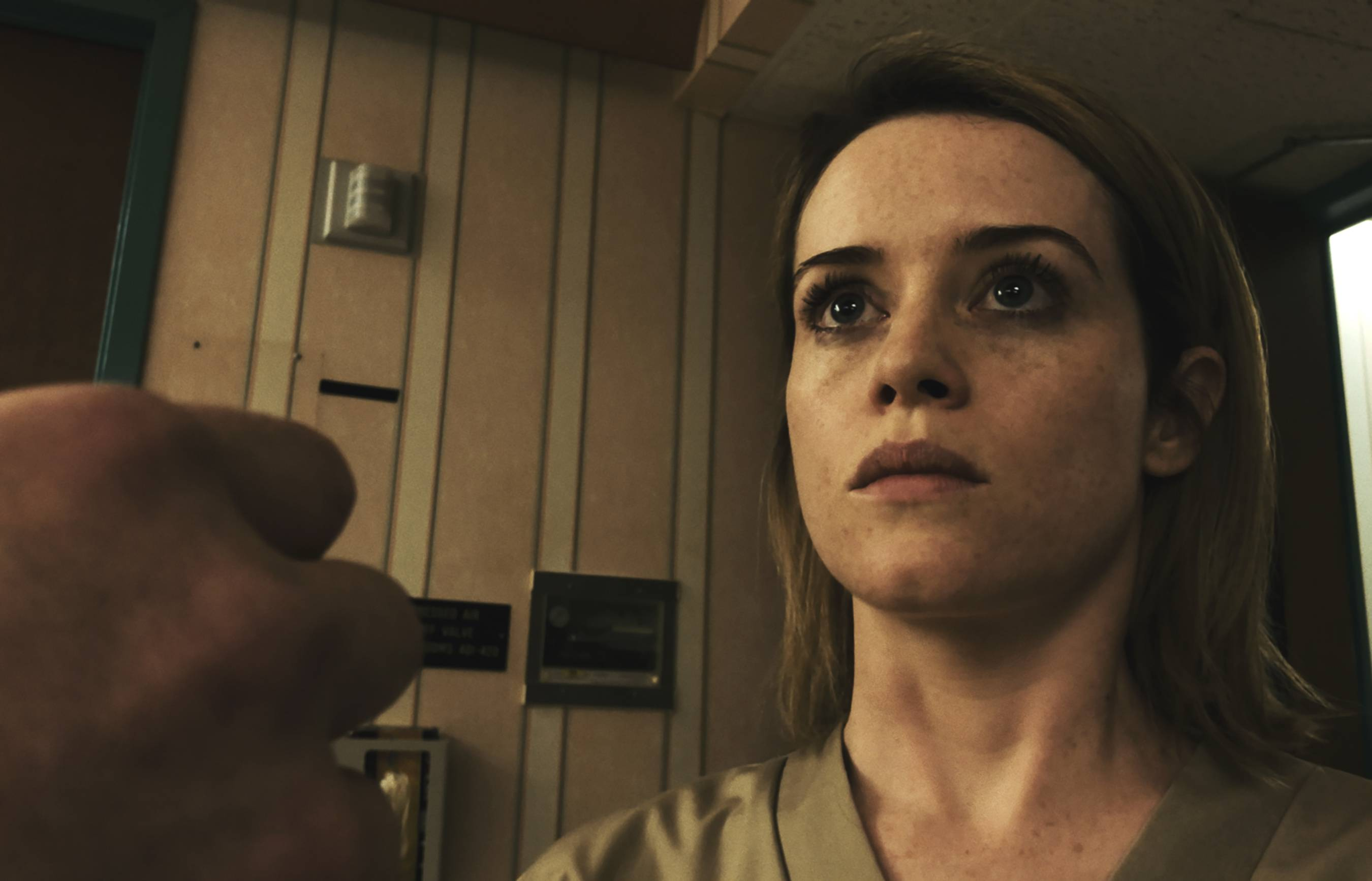 "A seemingly paranoid woman (Claire Foy) keeps seeing a stalker in ""Unsane."""