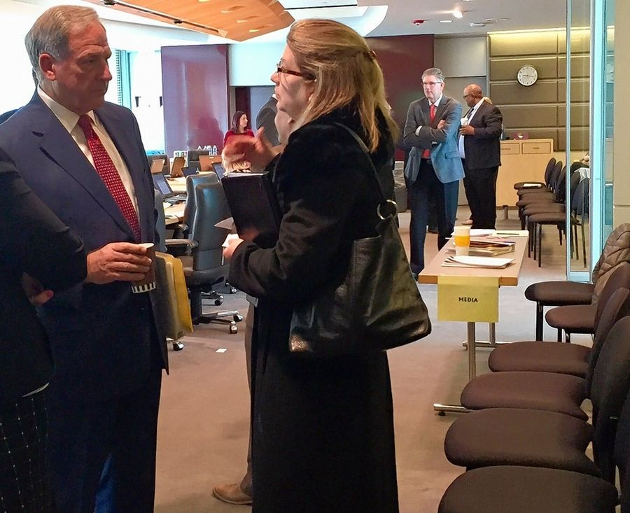 Tollway Chairman Robert Schillerstrom talks to a visitor after Thursday's board meeting was canceled when not enough directors showed up.