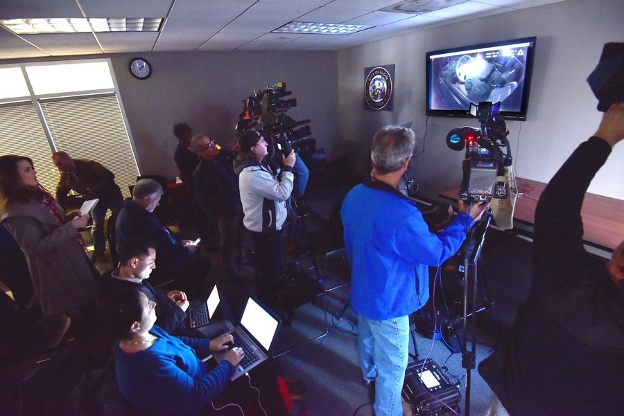 A video is shown during a news conference Thursday at the Elgin Police Department. The video showed the shooting of Elgin resident Decynthia Clements during a traffic stop March 12th.