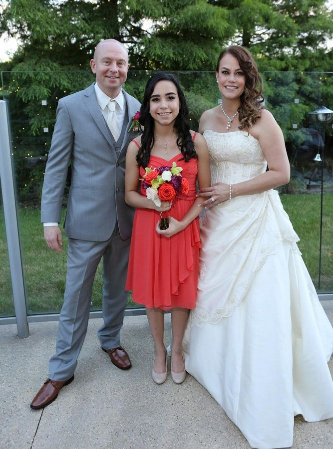 Scott Buckingham and his now-wife Janina are pictured with his stepdaughter, Janedis, on his wedding day in the summer of 2016. Buckingham, 45, is seeking a living kidney donor.