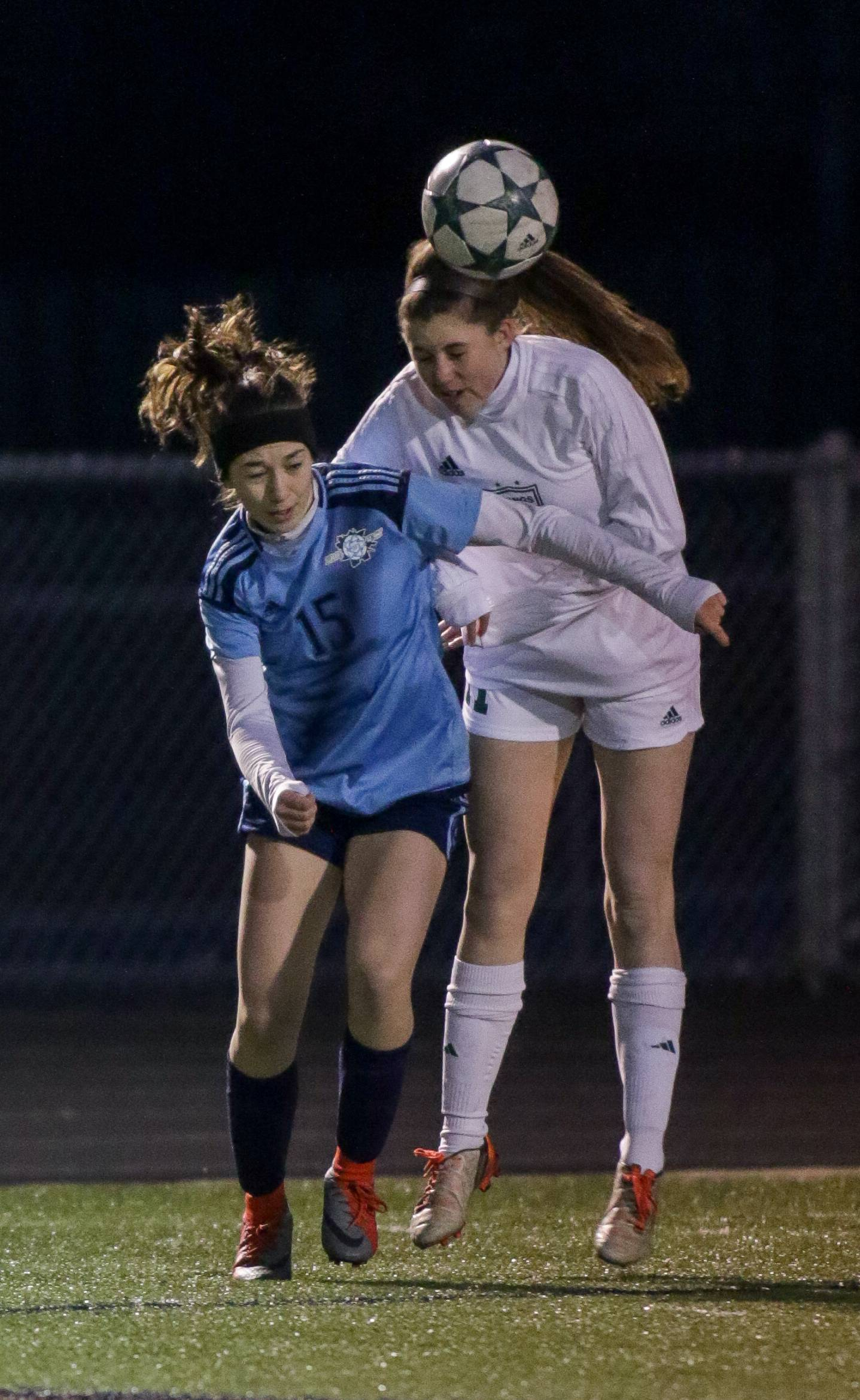 Prospect's Ashley Welk, left, and Fremd's Madeline McCarthy, right, head the ball Thursday in Palatine.